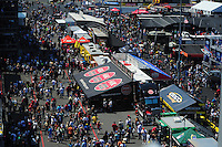 Apr. 14, 2012; Concord, NC, USA: NHRA fans walk through the manufacturers midway in the pits during qualifying for the Four Wide Nationals at zMax Dragway. Mandatory Credit: Mark J. Rebilas-