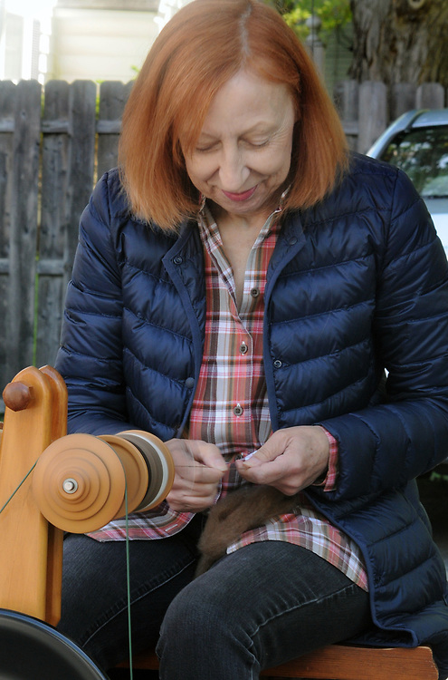 A spinning wheel demonstration by Mariepaule Rossur of Cottage on the Hudson Crafts, where everything is made from wool, on the Opening Day of the 2017 Saugerties Farmer's Market on Saturday, May 27, 2017. Photo by Jim Peppler. Copyright/Jim Peppler-2017.
