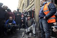 """Roma 13 Gennaio """"014<br /> Pietre d'Inciampo,Stolpersteine, davanti il carcere di  Regina Coeli per Jean Bourdet e Paskvala Blesevic prigionieri politici e deportati a Mauthausen.Sampietrini rivestiti d'una placca d'ottone lucente incastonati a terra di fronte ai portoni di deportati e vittime del nazismo. L'idea è dell'artista tedesco Gunther Demnig nell'ambito del progetto «Memorie d'Inciampo a Roma» che prevede in vari Municipi il posizionamento di pietre , ciascuna dedicata ad un deportato per ragioni razziali, politiche e militari, di fronte alle loro abitazioni.<br /> Stumbling stones in front of the Regina Coeli prison for Jean Bourdet and Paskvala Blesevic political prisoners and deported to Mauthausen.Covered cobblestones of a shiny brass plaque embedded in the ground in front of the gates of deportees and victims of Nazism. The artist Gunther Demnig provides in various municipalities placement of stones, each dedicated to a deported for racial, political and military, in front of their houses."""