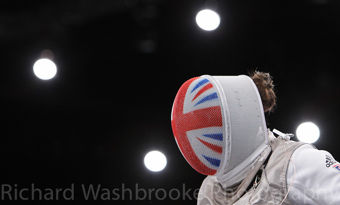 Paralympics London 2012 - ParalympicsGB - Wheelchair Fencing held at the Excel centre 4th September 2012  .Justine Moore competes in the Women's Individual Foil Cat. B Preliminary Pool at the Paralympic Games in London. .Photo: Richard Washbrooke/ParalympicsGB