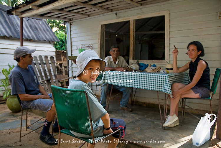 Senior tobacco farmer receiving guests at his home in Vinales, Pinar del Rio Province, Cuba.