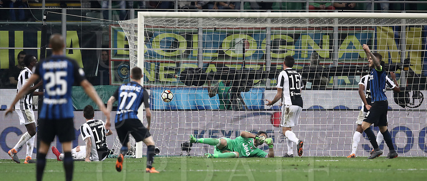 Calcio, Serie A: Inter - Juventus, Milano, stadio Giuseppe Meazza (San Siro), 28 aprile 2018.<br /> Juventus' Andrea Barzagli (c) scores an own goal for Inter Milan's second as Inter's captain Mauro Icardi (r) celebrates  during the Italian Serie A football match between Inter Milan and Juventus at Giuseppe Meazza (San Siro) stadium, April 28, 2018.<br /> UPDATE IMAGES PRESS/Isabella Bonotto