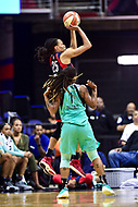 Washington, DC - June 15, 2018: Washington Mystics forward Monique Currie (25) shots a jump shot over New York Liberty guard Shavonte Zellous (1) during game between the Washington Mystics and New York Liberty at the Capital One Arena in Washington, DC. (Photo by Phil Peters/Media Images International)