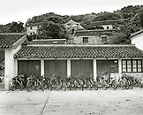 CHINA, Putou Shan, bicycles parked in front of residential structure on the island of Putou Shan (B&W)
