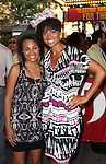 Amel Larrieux & Daughter.attending the opening night of the Broadway limited engagement of 'Fela!' at the Al Hirschfeld Theatre on July 12, 2012 in New York City.