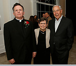 Waterbury, CT 110518MK14 (from left) Father Christopher Ford, Ron and Kathleen Picard gathered for the Sacred Heart High School awards dinner and silent auction held at the Aqua Turf. in Plantsvile. Michael Kabelka / Republican-American