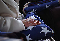 Dolly Goldberg, the mother of Sgt. David J. Goldberg of Layton, caressed the flag that she was presented at her son's burial.  Sarah Goldberg, the wife of Sgt. David Goldberg was also given a flag.  Sgt. Goldberg was killed November 26 in Qayyarah, Iraq.  He was put to rest at the North Plat of Salt Lake City Cemetery.  .Photo by Lisa Marie Miller.  12/05/03..Slug:  Goldberg Interment.