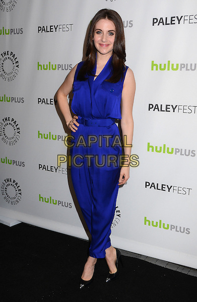 Alison Brie.The Paley Center For Media's PaleyFest 2013 Honoring 'Community' at Saban Theatre, Los Angeles, California, USA.  .March 5th, 2013.full length blue silk satin jumpsuit hand on hip sleeveless.CAP/ADM/BT.©Birdie Thompson/AdMedia/Capital Pictures.