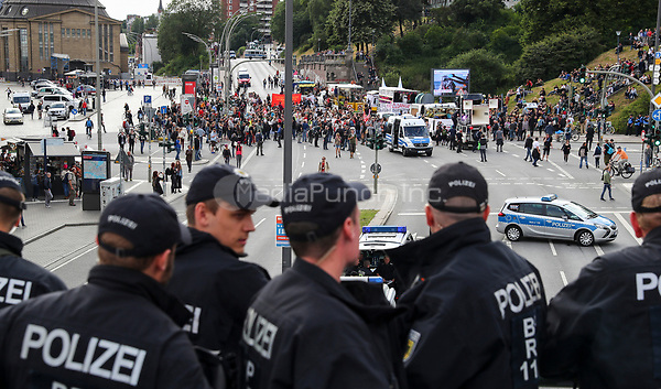 Participants of a demonstration against the upcoming G20 Summit are being watched by police officers at the Landungsbruecken (lit. landing bridges) in Hamburg, Germany, 05 July 2017. The heads of the leading industrial nations meet for the G20 Summit in Hamburg 6-7 July. Photo: Christian Charisius/dpa /MediaPunch ***FOR USA ONLY***