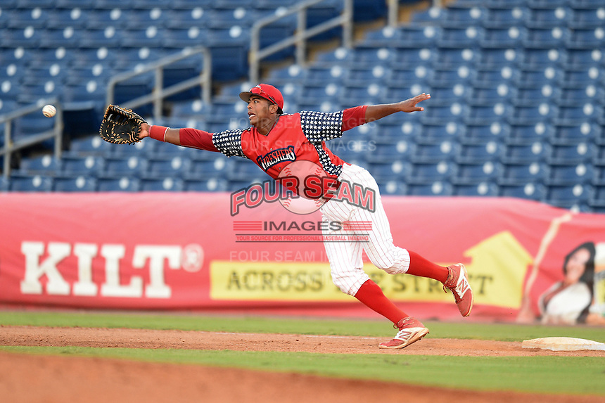 Clearwater Threshers first baseman Art Charles (24) stretches for an errant throw during a game against the Brevard County Manatees on June 28, 2014 at Bright House Field in Clearwater, Florida.  Brevard County defeated Clearwater 6-4.  (Mike Janes/Four Seam Images)