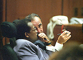 Lead defense attorney Johnnie L. Cochran, Jr., left, confers with attorney Robert Shapiro, right, during the trial of former NFL star running back O.J. Simpson for the murder of his former wife, Nicole Brown Simpson and a friend of hers, restaurant waiter, Ron Goldman in Los Angeles County Superior Court in Los Angeles, California on July 13, 1995.<br /> Credit: Steve Grayson / Pool via CNP