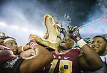 Florida State lineman Wilson Bell celebrates defeating Florida 31-13 in an NCAA college football game in Tallahassee, Fla., Saturday, Nov. 26, 2016. (AP Photo/Mark Wallheiser)