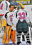 28 January 2012: University of Vermont Catamount goaltender Rob Madore, a Senior from Pittsburgh, PA, gives some encouraging words to starting goaltender Alex Vazzano (33), a Sophomore from Trumbull, CT, prior to facing the Northeastern University Huskies at Gutterson Fieldhouse in Burlington, Vermont. The Catamounts, dressed in their Breast Cancer Awareness jerseys, fell to the Huskies 4-2 in the second game of their 2-game Hockey East weekend series. Mandatory Credit: Ed Wolfstein Photo