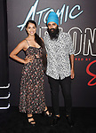 LOS ANGELES, CA - JULY 24:  Youtuber Lilly Singh (L) and guest arrive at the Premiere Of Focus Features' 'Atomic Blonde' at The Theatre at Ace Hotel on July 24, 2017 in Los Angeles, California.