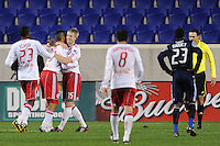 John Wolyniec (15) of the New York Red Bulls celebrates scoring with teammates Connor Chinn (25) and Tony Tchani (23)during a U. S. Open Cup qualifier round match at Red Bull Arena in Harrison, NJ, on May 12, 2010.