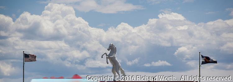 Denver Bronco statue and flags at Mile High Stadium, Denver, CO.