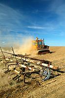 A farmer tills his wheat fields on farmland near Ritzville, Eastern Washington