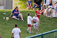 A young fan cheers after catching a foul ball during a game between the Arkansas Travelers and the Springfield Cardinals at Hammons Field on June 12, 2012 in Springfield, Missouri. (David Welker/Four Seam Images)