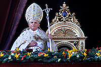 Pope Benedict XVI blesses his faithful as he leads his Urbi et Orbi message (to the city and the world) from the central balcony of Saint Peter's Square at the Vatican . December. 25, 2007.. .