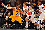 SIOUX FALLS, SD - MARCH 11:  Kory Brown #22 from North Dakota State University applies pressure to Jack Houpt #32 from Western Illinois University in the second half or their semifinal game Monday night at the 2013 Summit League Championship in Sioux Falls, SD.  (Photo by Dave Eggen/Inertia)