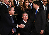 Speaker of the United States House of Representatives Paul Ryan (R-WI) (R) shakes hands with former US  President George W. Bush as the late former President George H.W. Bush lies in state inside the Rotunda of the US Capitol, December 3, 2018 in Washington, DC. - The body of the late former President George H.W. Bush travelled from Houston to Washington, where he will lie in state at the US Capitol through Wednesday morning. Bush, who died on November 30, will return to Houston for his funeral on Thursday. (Photo by Brendan Smialowski / POOL / AFP)