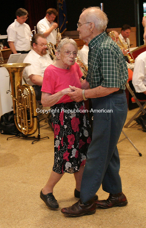 TORRINGTON, CT 12 July 2005 -071205BZ07- Josephine and Alexander Sesko, of Winsted, dance to the sounds of the Leo Liddle &quot;Big Band&quot; Tuesday night.<br /> Jamison C. Bazinet Photo