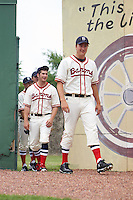 Birmingham Barons Tony Bucciferro (right), Tyler Danish and teammates walk through the outfield before the 20th Annual Rickwood Classic Game against the Jacksonville Suns on May 27, 2015 at Rickwood Field in Birmingham, Alabama.  Jacksonville defeated Birmingham by the score of 8-2 at the countries oldest ballpark, Rickwood opened in 1910 and has been most notably the home of the Birmingham Barons of the Southern League and Birmingham Black Barons of the Negro League.  (Mike Janes/Four Seam Images)