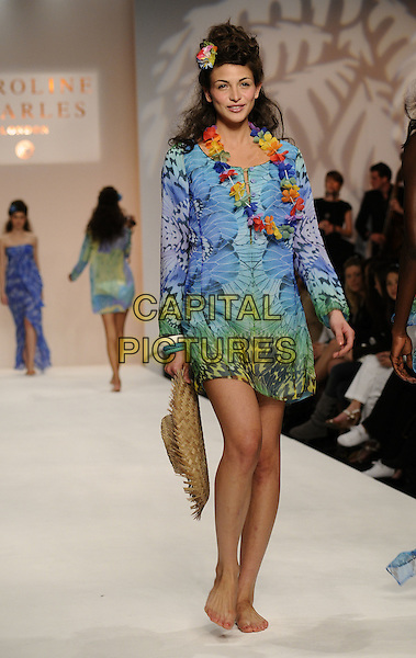 MODEL.LFW: Caroline Charles s/s 2009 catwalk show, BFC Tent, natural History Museum, London, England..September 14th, 2008.London Fashion Week full length blue pattern dress yellow purple tropical flowers lei .CAP/CAN.©Can Nguyen/Capital Pictures.