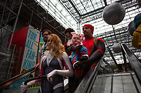 NEW YORK, USA - October 3: Atendees to the NYC Comic Con DAY ONE on October 3, 2019 in New York, USA.<br /> The 2019 New York Comic-Con at the Jacob K. Javits Convention Center Day 1 with the latest in superhero movies, sci-fi shows, animation, video games, comic book releases available to attendees.<br /> (Photo by Luis Boza/VIEWpress/Corbis via Getty Images)