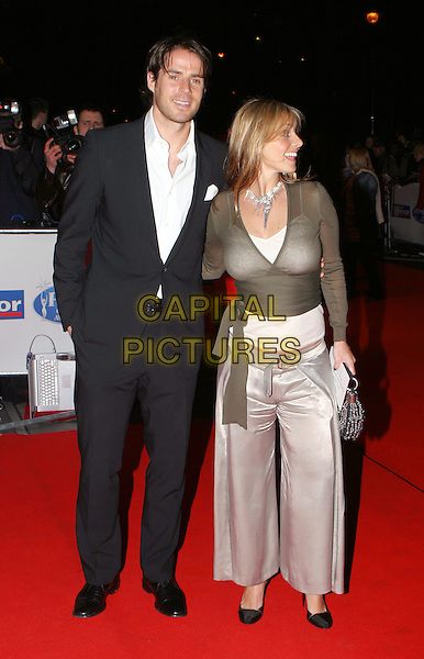 LOUISE & JAMIE REDKNAPP .Daily Mirror's Pride Of Britain Awards at the London Hilton, Park Lane.15 March 2004.full length, full-length, trousers, green wrap around top, silk, satin trousers.www.capitalpictures.com.sales@capitalpictures.com.© Capital Pictures.