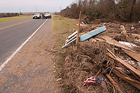 At a police check point on the road to the Bolivar Peninsula, an American flag lies rumpled amidst debris from Hurricane Ike in 2008.