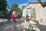 Seven-year old Iznaida Dalmas jumps rope in front of her family's new home in Picmy, a village on the Haitian island of La Gonave where Service Chr&eacute;tien d&rsquo;Ha&iuml;ti is working with survivors of Hurricane Matthew, which struck the region in 2016. Holding the rope are her brothers Dwendy and Vestander as her mother looks on.<br /> <br /> SCH, a member of the ACT Alliance, is helping families like this one repair or rebuild their homes on the island.