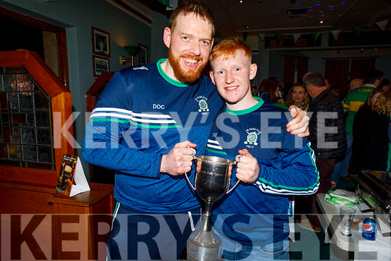 Na Gaeil footballers Dan O'Connor and Dan Goggin holding the All Ireland Junior championship Cup, in the clubhouse on Saturday night