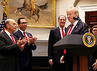 United States President Donald J. Trump announces David Malpass as his choice to serve as president of the World Bank, in the Roosevelt Room of the White House, in Washington, DC, February 6, 2019.  Pictured at left are: United States Secretary of Commerce Wilbur L. Ross, Jr., United States Secretary of the Treasury Steven T. Mnunchin. Photo Credit: Martin H. Simon / CNP/AdMedia