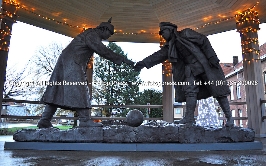 """25/12/14<br /> <br /> A sculpture depicting two WW1 soldiers playing football during the famous Christmas Day truce is displayed in the field near Messine, Belgium, close to where the match was played in Flanders, Belgium.<br /> <br /> The sculpture, made in England, arrived in Flanders on Christmas Eve, and was first displayed in the town centre before being taken to the spot where the match was played. <br /> <br /> Sculpted by Andy Edwards the work is entitled 'All Together Now', recalling the song by the band The Farm - which was inspired by the truce. <br /> <br /> Chris Butler said: """"Castle Fine Arts are proud to have cast a number of war memorials over the years. We are honoured to support this sculpture for peace. I believe it will touch the hearts of millions.""""<br /> <br /> <br /> """"It will be a symbol of peace and hope and a call for a renewed worldwide cessation of violence in honour of those brave boys who 'joined together and decided not to fight'"""".<br /> <br /> <br /> The statue depicts the meeting of a British and a German soldier over a football, deep in the mud between the lines on that first Christmas of the war. The soldiers appear to be shaking hands but  are not not quite touching, forming a space in which a visitor can insert their own hand to complete the union.  A chance for a moments reflection on how far we are from true peace and brotherhood and the part each of us has to play in that dream. We want the work to stand as both a celebration of this inspirational and heroic event and as symbol of hope and peace. <br /> <br /> The project was instigated some years ago, with the support of the Football Asscociation (FA), as football's contribution to the First World War commemorations. <br /> <br /> All Rights Reserved - F Stop Press. www.fstoppress.com. Tel: +44 (0)1335 300098"""
