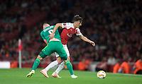 Mesut Özil of Arsenal & Mykhaylo Serhiychuk of Vorskla Poltava during the UEFA Europa League match group between Arsenal and Vorskla Poltava at the Emirates Stadium, London, England on 20 September 2018. Photo by Andrew Aleks / PRiME Media Images.