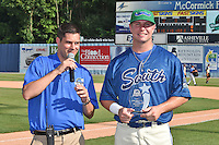 Asheville Tourists broadcast/media relations manager Doug Mauer presents trophy to Home Run Derby champion Lexington Legends infielder Ryan O'Hearn (22) after the South Atlantic League All Star Game Home Run Derby on June 23, 2015 in Asheville, North Carolina. The North Division defeated the South 7-5(Tony Farlow/Four Seam Images)