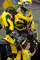 NWA Democrat-Gazette/JASON IVESTER<br /> Kiefer Mitchell, 2, of Pea Ridge stands by Transformers character Bumblebee for a photo Monday, June 12, 2017, outside the Wal-Mart Supercenter on Walnut Street in Rogers. The character is part of a five-month tour around Wal-Mart stores promoting the upcoming movie, Transformers: The Last Knight, which releases later this month. The tour will make stops at Wal-Mart stores in Fort Smith on Thursday and the Wal-Mart on Martin Luther King Jr Boulevard in Fayetteville on Thursday at 5:30.