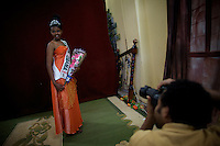 Salam, 19 years old, winner of the Miss Obama beauty pageant held at the Obama Cafe In Amhara's regional capital Bahir Dar has her portrait taken by a local photographer  on President Barack Obama's inauguration day, Tuesday January 20 2009..