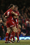 George North and Dan Biggar celebrate with Rhys Webb after the scrum half scores a try for Wales.<br /> Dove men Series 2014<br /> Wales v New Zealand<br /> 22.11.14<br /> &copy;Steve Pope -SPORTINGWALES