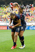 Carli Lloyd, Angela Hucles. The USWNT defeated Canada, 1-0, at Suwon World Cup Stadium in Suwon, South Korea, to win the Peace Queen Cup.
