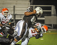 Mt. Carmel defensive lineman Steve Richardson takes down Morgan Park's Desmond Earles for a loss Friday night