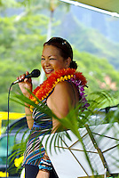 Local Hawaiian entertainer and singer Melveen Leed, wearing three flower lei, performing at Windward Community College ho'olaulea festival in the community of Kaneohe, Oahu. Melveen often sings about Hawaiian cowboys -- paniolos. One of her famous s