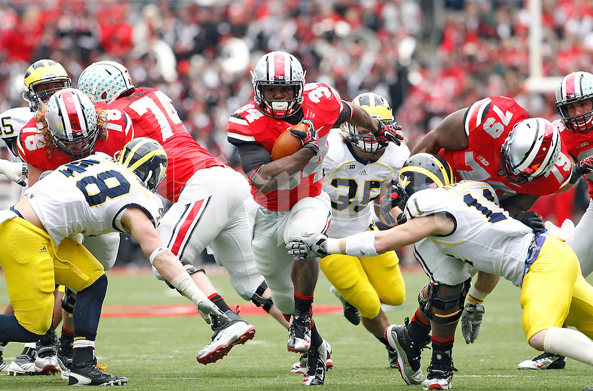 Ohio State Buckeyes running back Carlos Hyde (34) runs past Michigan Wolverines safety Jordan Kovacs (11) for a first down in the 2nd quarter during their college football game at Ohio Stadium, November 24, 2012.  (Dispatch photo by Kyle Robertson)
