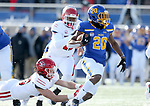 BROOKINGS, SD - NOVEMBER 17: Pierre Strong, Jr. #20 from South Dakota State University steps out of the grasp from Jack Cochrane #39 from the University of South Dakota during their game Saturday afternoon at Dana J. Dykhouse Stadium in Brookings, SD. (Photo by Dave Eggen/Inertia)