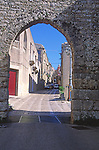 Entrance arch  and alleyway medieval street, Erice, Sicily, Italy