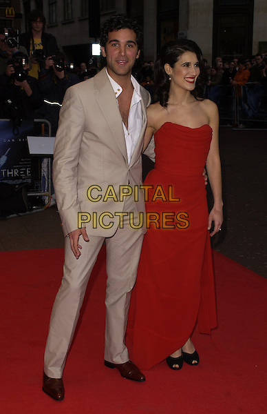"""JUAN PABLO DE PACE & MARIA VICTORIA DE PACE.World Premiere of """"Three"""" at the Odeon West End, Leicester Square, London, UK..May 2nd, 2006.Ref: CAN.full length red strapless dress beige suit brother sister siblings family.www.capitalpictures.com.sales@capitalpictures.com.©Capital Pictures"""