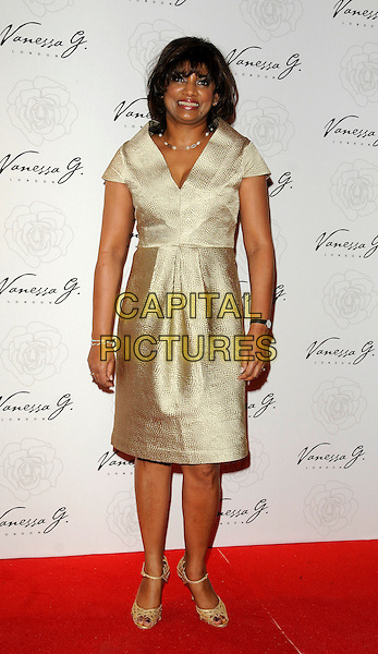 VANESSA G (Vanessa Gounden).The Vanessa G new designer label launch, Banqueting House Whitehall, London, England, UK..March 23rd, 2011.full length gold metallic sleeveless dress .shoes CAP/CAN.©Can Nguyen/Capital Pictures.