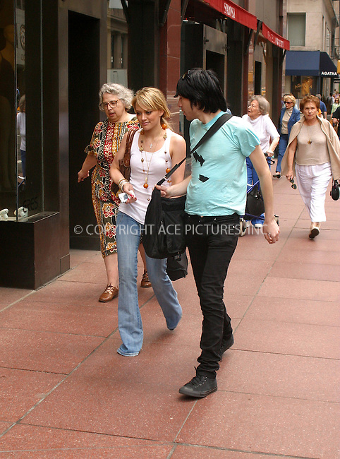 WWW.ACEPIXS.COM . . . . .  ....NEW YORK, JUNE 16, 2005....A dressed down Hilary Duff walks with an unnamed young man to her midtown hotel after lunching at Tao.....Please byline: PAUL CUNNINGHAM - ACE PICTURES..... *** ***..Ace Pictures, Inc:  ..Craig Ashby (212) 243-8787..e-mail: picturedesk@acepixs.com..web: http://www.acepixs.com