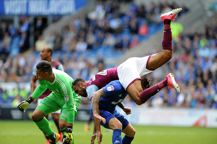 Aston Villa's Ahmed Elmohamady collides with Cardiff City's Lee Camp <br /> <br /> Photographer Ashley Crowden/CameraSport<br /> <br /> The EFL Sky Bet Championship - Cardiff City v Aston Villa - Saturday August 12th 2017 - Cardiff City Stadium - Cardiff<br /> <br /> World Copyright &copy; 2017 CameraSport. All rights reserved. 43 Linden Ave. Countesthorpe. Leicester. England. LE8 5PG - Tel: +44 (0) 116 277 4147 - admin@camerasport.com - www.camerasport.com